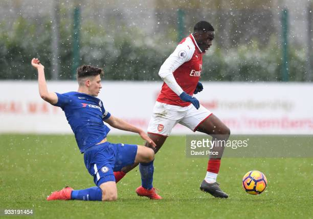 Josh Dasilva of Arsenal takes on Ruben Sammut of Chelsea during the match between Arsenal U23 and Chelsea U23 at London Colney on March 17 2018 in St...
