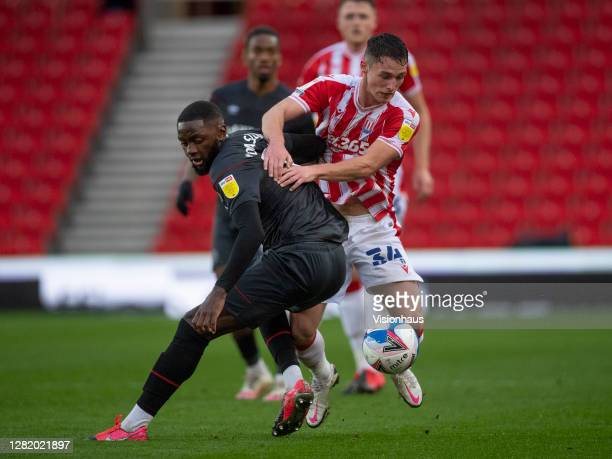 Josh Dasilva of Brentford and Jordan Thompson of Stoke City in action during the Sky Bet Championship match between Stoke City and Brentford at...