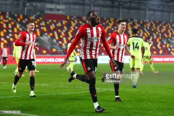 Josh Dasilva of Brentford celebrates after scoring their team's first goal during the Carabao Cup Quarter Final match between Brentford and Newcastle...