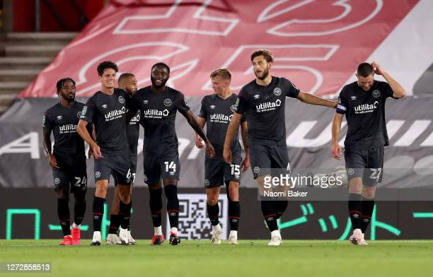 Josh Dasilva of Brentford celebrates with teammates after scoring his team's second goal during the Carabao Cup Second Round match between...
