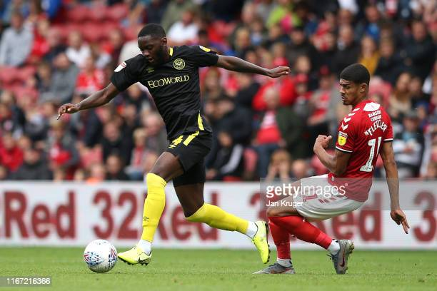 Josh Dasilva of Brentford is tackled by Ashley Fletcher of Middlesbrough during the Sky Bet Championship match between Middlesbrough and Brentford at...