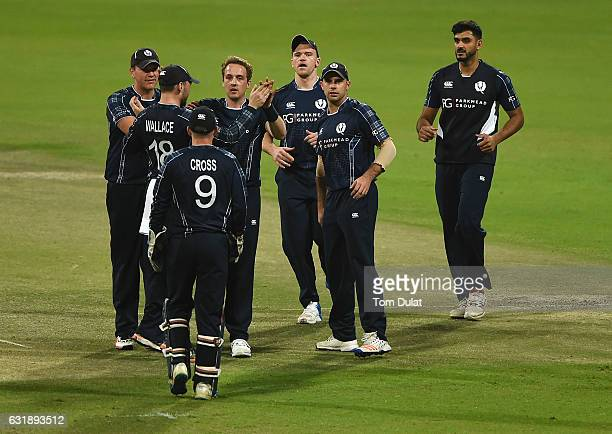 Josh Davey of Scotland celebrates taking the wicket of Michael Rippon of Netherlands during the Desert T20 Challenge match between Netherlands and...
