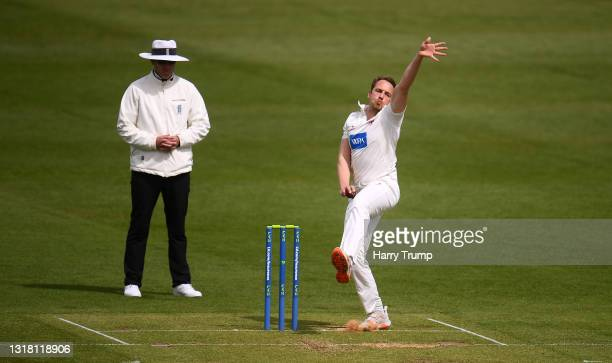 Josh Davey of Somerset in bowling action as Match Umpire Russell Warren looks on during Day Three of the LV= Insurance County Championship match...