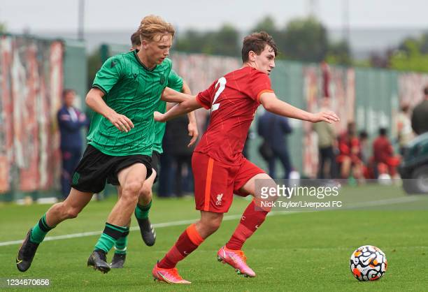 Josh Davidson of Liverpool and Jack Griffiths of Stoke City in action during the U18 Premier League game at AXA Training Centre on August 14, 2021 in...