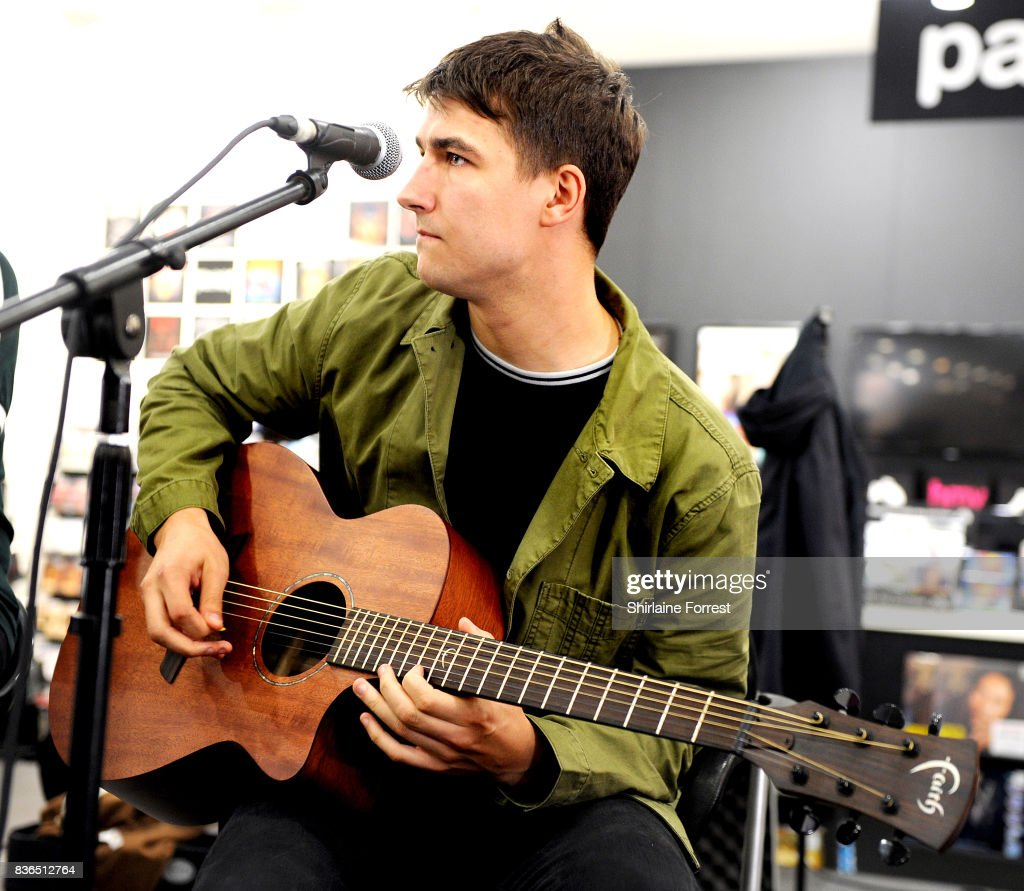 Josh Davidson of The Sherlocks performs live and signs copies of their debut album 'Live for the Moment' during an instore session at HMV Manchester on August 21, 2017 in Manchester, England.