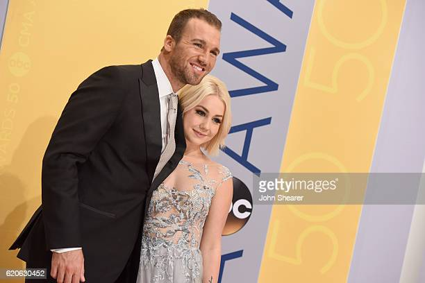 Josh Davis and singersongwriter Raelynn attend the 50th annual CMA Awards at the Bridgestone Arena on November 2 2016 in Nashville Tennessee