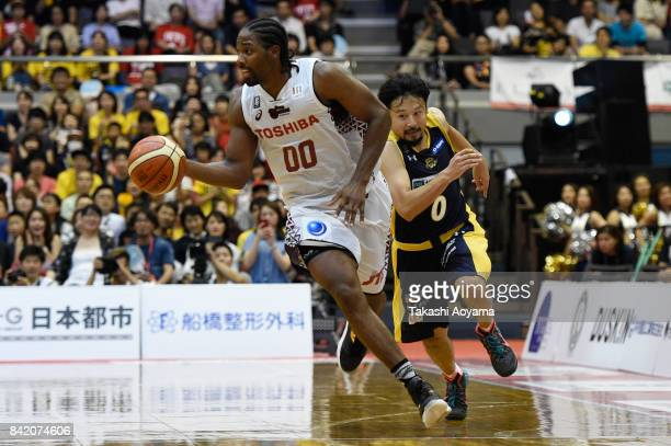 Josh Davis of the Kawasaki Brave Thunders drives past Yuta Tabuse of the Tochigi Brex during the BLeague Kanto Early Cup 3rd place match between...