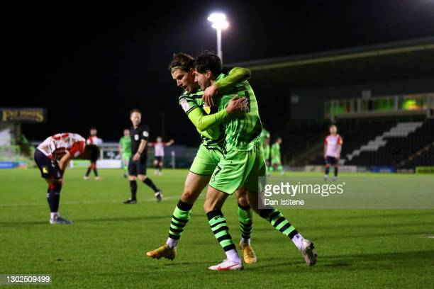 Josh Davison of Forest Green Rovers celebrates with team-mate Isaac Hutchinson after scoring his team's fourth goal during the Sky Bet League Two...