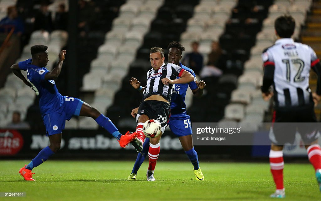 Josh Debayo of Leicester City in action with Shaun Tuton of Grimsby Town during the checkatrade Trophy match between Grimsby Town and Leicester City at Blundell Park on September 04, 2016 in Grimsby, United Kingdom.