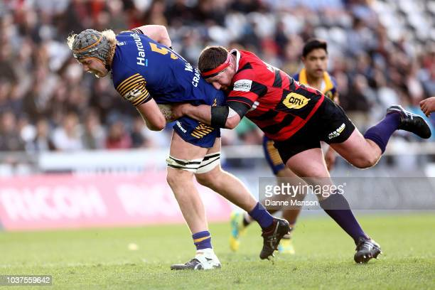 Josh Dickson of Otago is tackled by Chris King of Canterbury during the round six Mitre 10 Cup match between Otago and Canterbury at Forsyth Barr...