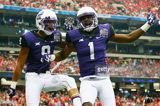 Josh Doctson celebrates his touchdown with Emanuel Porter of the TCU Horned Frogs in the second quarter against the Ole Miss Rebels during the...