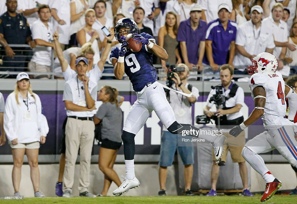 Josh Doctson #9 of the TCU Horned Frogs catches a touchdown pass as David Johnson #4 of the Southern Methodist Mustangs looks on in the second quarter at Amon G. Carter Stadium on September 19, 2015 in Fort Worth, Texas.