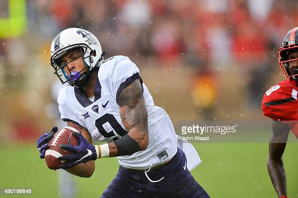Josh Doctson of the TCU Horned Frogs comes down with the ball against the Texas Tech Red Raiders on September 26 2015 at Jones ATT Stadium in Lubbock...