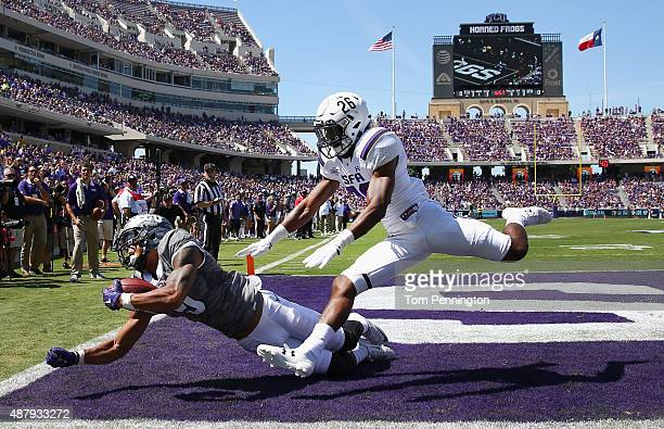 Josh Doctson of the TCU Horned Frogs fails to hang onto a touch down pass under coverage from Demundre Freeman of the Stephen F Austin Lumberjacks in...