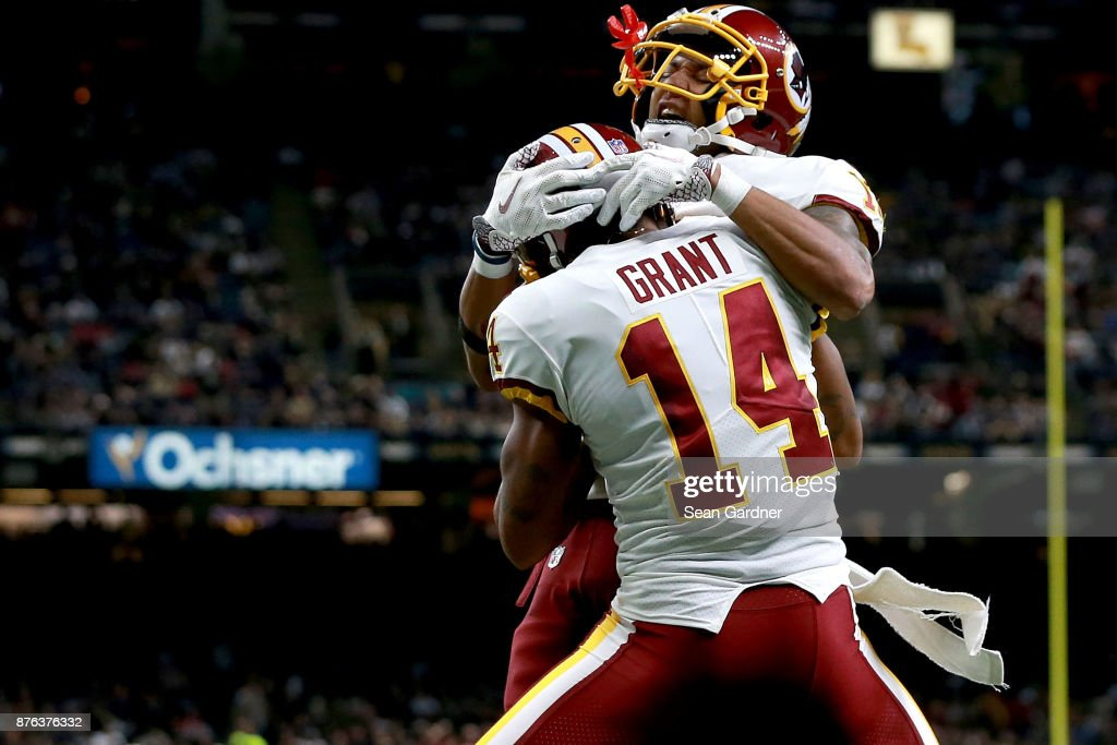Josh Doctson #18 of the Washington Redskins and Ryan Grant #14 of the Washington Redskins celebrate after scoring a touchdown against the New Orleans Saints during the second half at the Mercedes-Benz Superdome on November 19, 2017 in New Orleans, Louisiana.