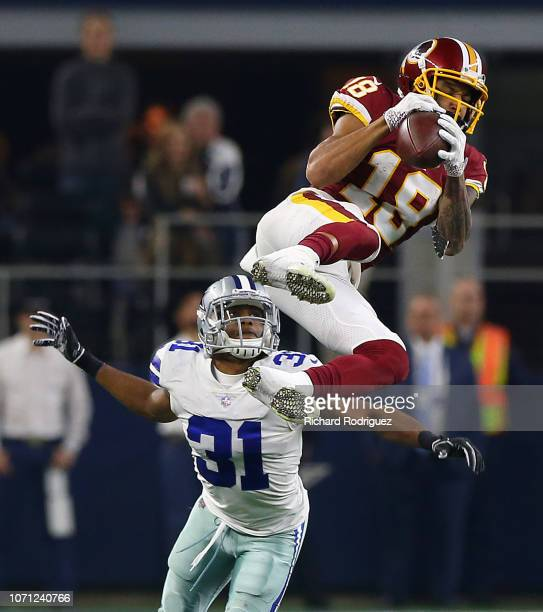 Josh Doctson of the Washington Redskins catches a pass in front of Byron Jones of the Dallas Cowboys in the fourth quarter at ATT Stadium on November...