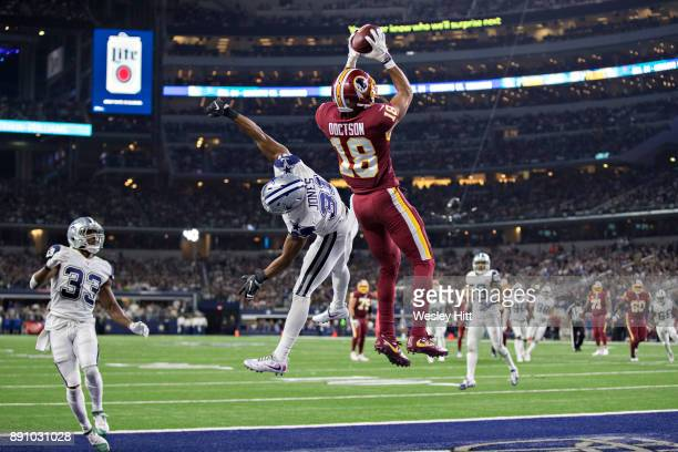 Josh Doctson of the Washington Redskins catches a touchdown pass in the end zone over Byron Jones of the Dallas Cowboys at ATT Stadium on November 30...