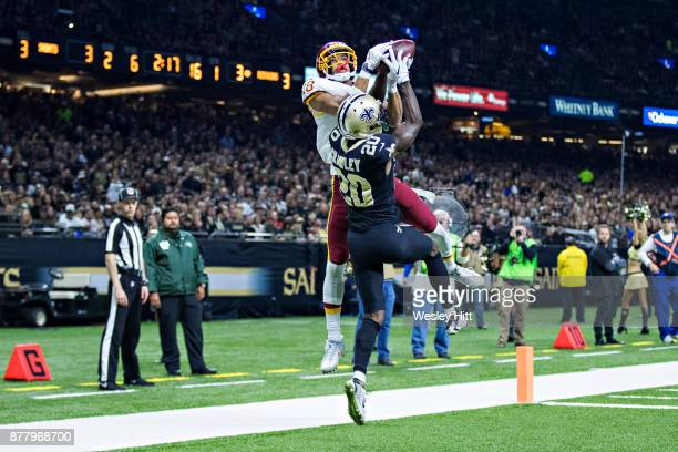 Josh Doctson of the Washington Redskins goes up for a pass in the end zone but lands out of bounds against Ken Crawley of the New Orleans Saints at...