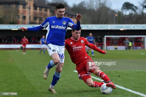 Josh Doherty of Crawley Town and Jonny Smith of Oldham Athletic during the Sky Bet League 2 match between Crawley Town and Oldham Athletic at...