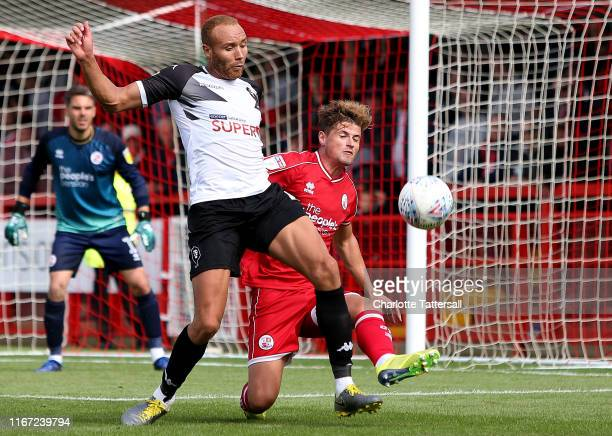 Josh Doherty of Crawley Town slides in to tackle Lois Maynard of Salford City during the Sky Bet League Two match between Crawley Town and Salford...