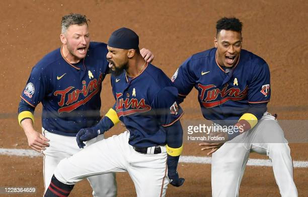 Josh Donaldson, Byron Buxton and Jorge Polanco of the Minnesota Twins celebrate Buxton's walk-off single by against the Detroit Tigers during the...