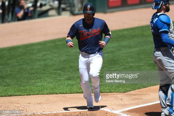 Josh Donaldson crosses home plate to score the two millionth run in MLB history off an RBI double by Nelson Cruz of the Minnesota Twins in the first...