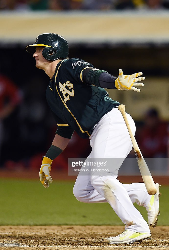 Josh Donaldson #20 fo the Oakland Athletics hits an RBI single scoring Jed Lowrie #8 in the bottom of the ninth inning against the Washington Nationals at O.co Coliseum on May 10, 2014 in Oakland, California.