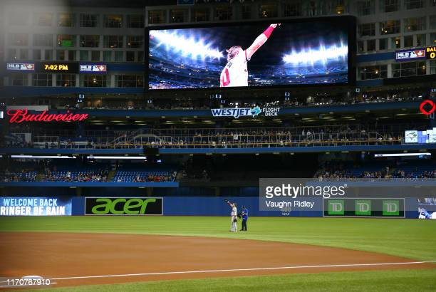 Josh Donaldson of the Atlanta Braves acknowledges applause from the crowd after a video tribute on the big screen prior to the first inning of a MLB...