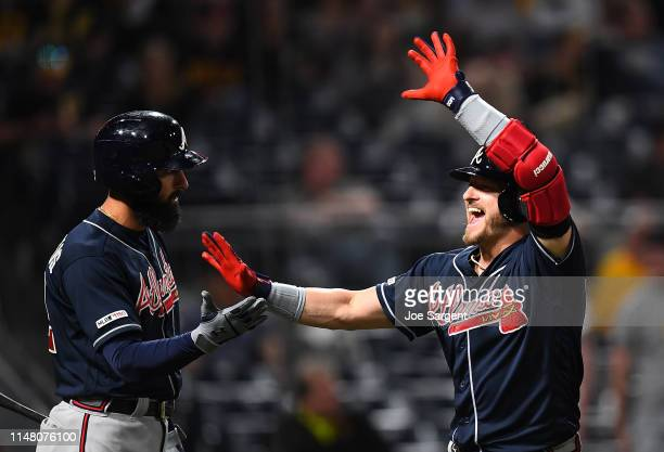 Josh Donaldson of the Atlanta Braves celebrates his three run home run with Nick Markakis during the eighth inning against the Pittsburgh Pirates at...