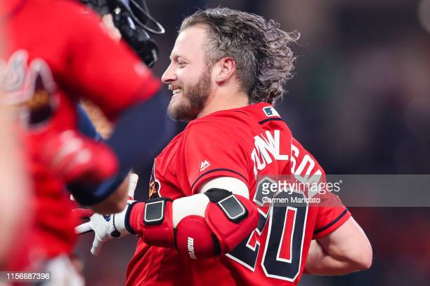 Josh Donaldson of the Atlanta Braves celebrates with his teammates after hitting the game winning single in the ninth inning during the game against...