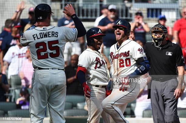 Josh Donaldson of the Atlanta Braves celebrates with Ozzie Albies and Tyler Flowers after hitting a threerun home run against the Colorado Rockies at...
