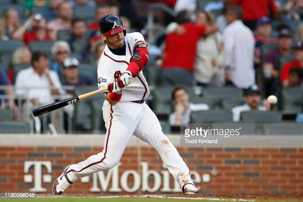 Josh Donaldson of the Atlanta Braves hits a solo home run against the St. Louis Cardinals during the fourth inning in game five of the National...