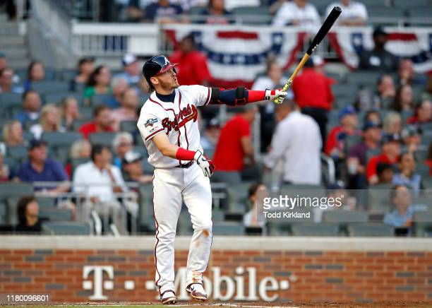 Josh Donaldson of the Atlanta Braves hits a solo home run against the St Louis Cardinals during the fourth inning in game five of the National League...