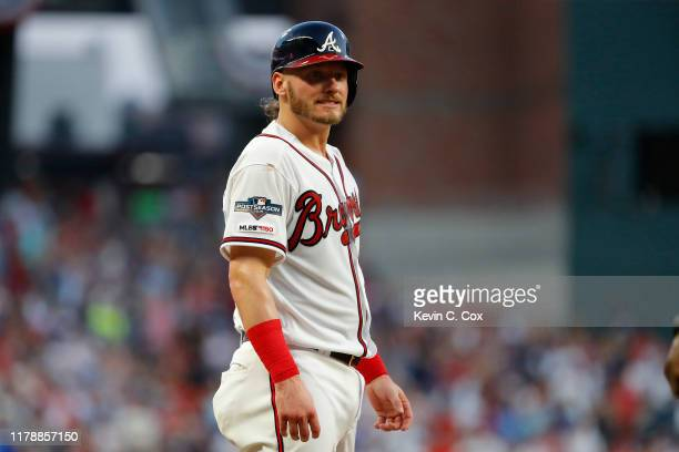 Josh Donaldson of the Atlanta Braves reacts after advancing to third base on a double by teammate Nick Markakis against the St Louis Cardinals during...