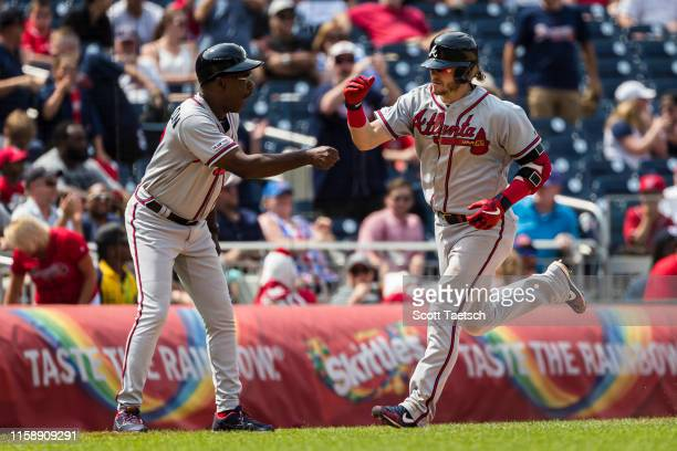 Josh Donaldson of the Atlanta Braves rounds the bases after hitting the game winning home run against the Washington Nationals during the tenth...