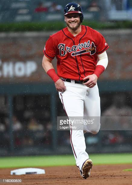 Josh Donaldson of the Atlanta Braves shares a smile while running to third base against the Miami Marlins at SunTrust Park on July 05 2019 in Atlanta...