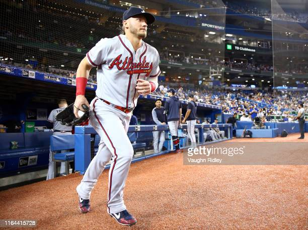 Josh Donaldson of the Atlanta Braves takes the field to warm up prior to the first inning of an MLB game against the Toronto Blue Jays at Rogers...