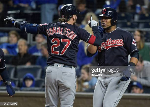 Josh Donaldson of the Cleveland Indians celebrates his grand slam with Edwin Encarnacion in the seventh inning against the Kansas City Royals at...
