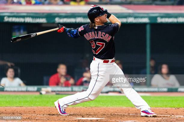 Josh Donaldson of the Cleveland Indians hits a solo home run to tie the game during the sixth inning against the Detroit Tigers at Progressive Field...