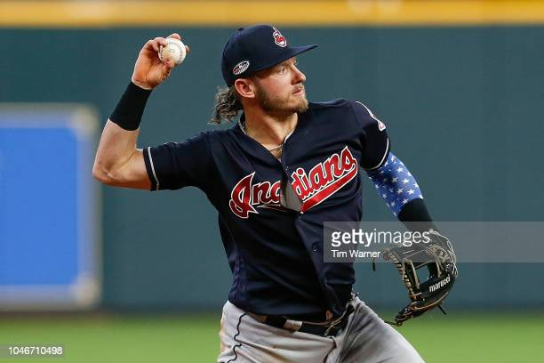 Josh Donaldson of the Cleveland Indians throws out a runner at first base in the second inning against the Houston Astros during Game Two of the...