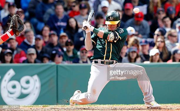 Josh Donaldson of the Oakland Athletics ducks from a close pitch against the Boston Red Sox in the third inning at Fenway Park on May 4 2014 in...
