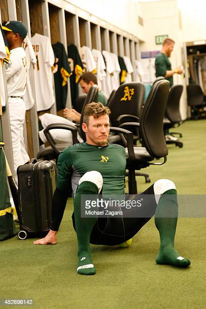 Josh Donaldson of the Oakland Athletics gets ready in the clubhouse prior to the game against the Toronto Blue Jays at Oco Coliseum on July 6 2014 in...