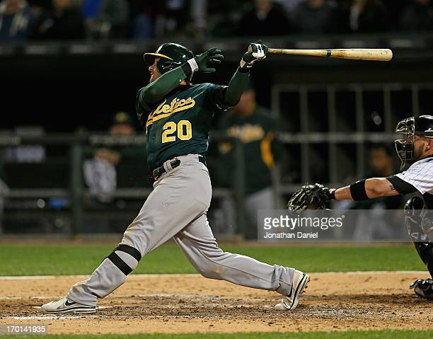 Josh Donaldson of the Oakland Athletics hits a grand slam home run in the 6th inning against the Chicago White Sox at US Cellular Field on June 7...