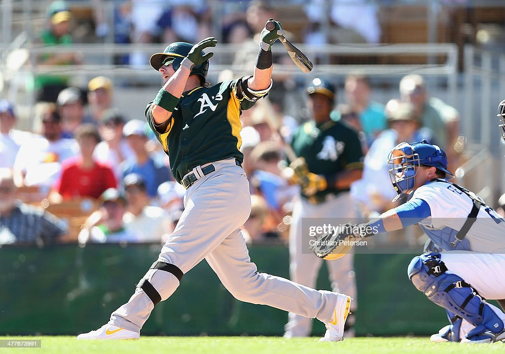 Josh Donaldson #20 of the Oakland Athletics hits a two-run home run against the Los Angeles Dodgers during the sixth inning of the spring training game at Camelback Ranch on March 10, 2014 in Glendale, Arizona.