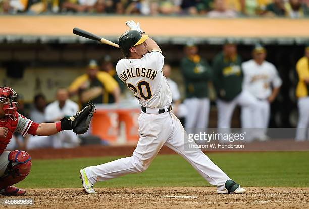 Josh Donaldson of the Oakland Athletics hits a walkoff tworun homer against the Philadelphia Phillies in the bottom of the tenth inning at Oco...