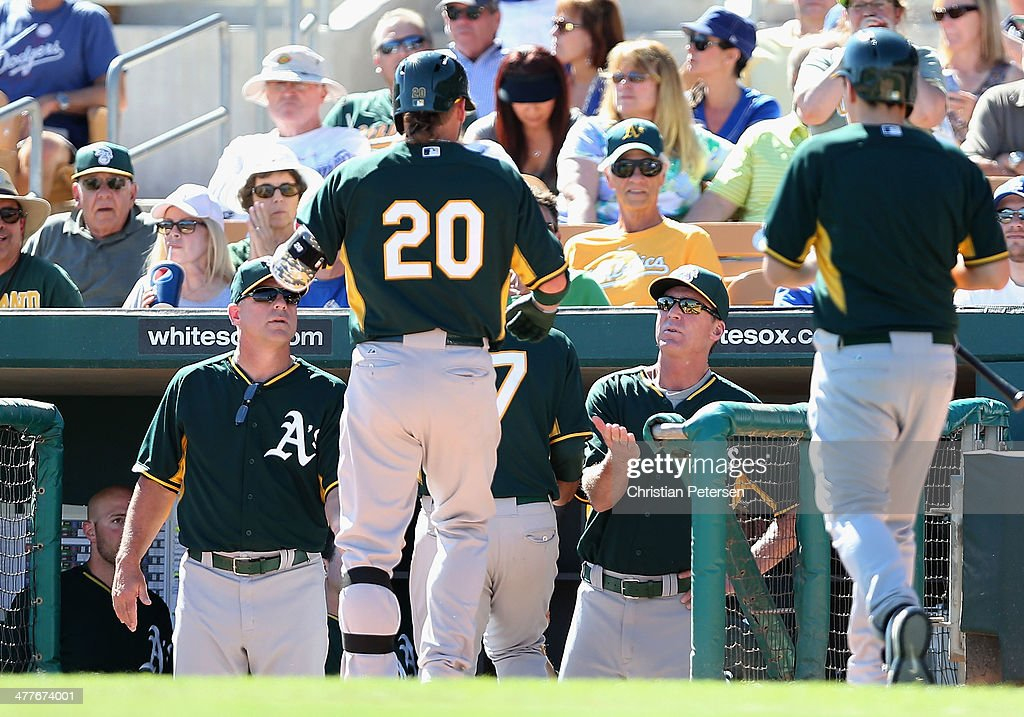 Josh Donaldson #20 of the Oakland Athletics is congratulated by manager Bob Melvin #6 after hitting a two-run home run against the Los Angeles Dodgers during the sixth inning of the spring training game at Camelback Ranch on March 10, 2014 in Glendale, Arizona.