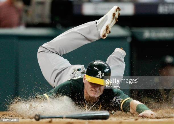 Josh Donaldson of the Oakland Athletics scores in the second inning on a single by teammate Derek Norris against the Houston Astros at Minute Maid...