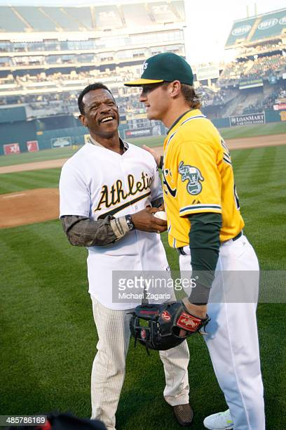 Josh Donaldson of the Oakland Athletics shakes hands with Rickey Henderson after Henderson throws out the first pitch prior to the game against the...