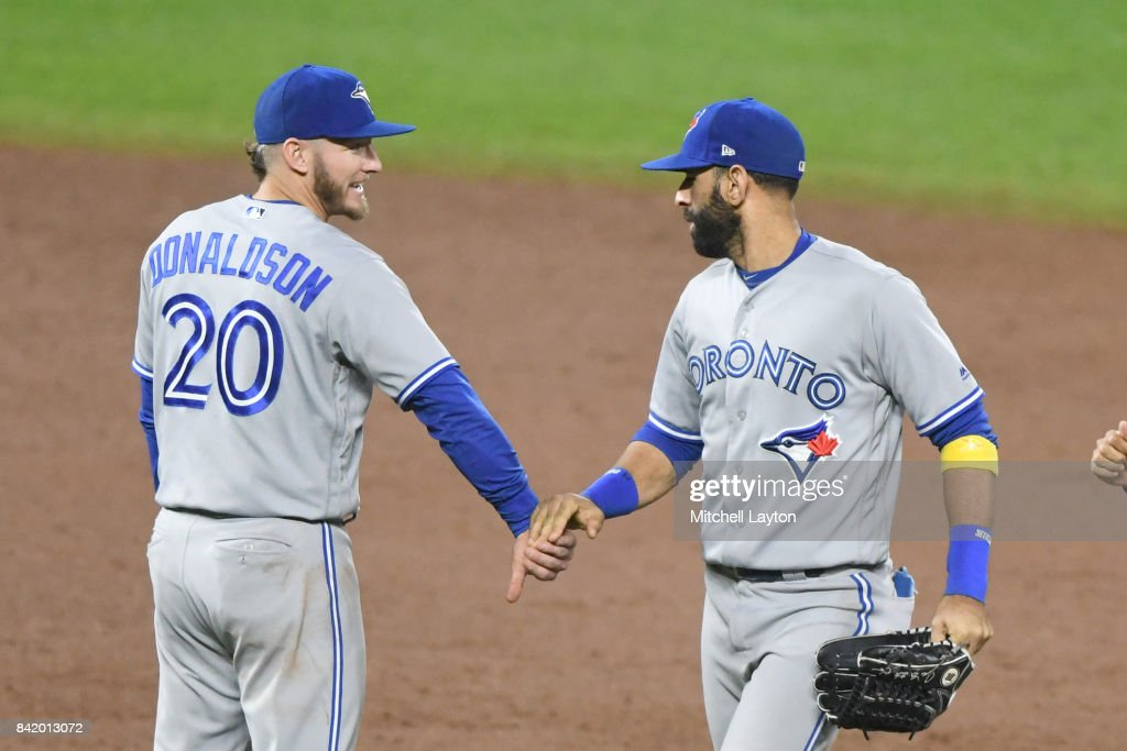 Josh Donaldson #20 of the Toronto Blue Jays and Jose Bautista #19 celebrate a win after a baseball game against the Baltimore Orioles at Oriole Park at Camden Yards on September 2, 2017 in Baltimore, Maryland.