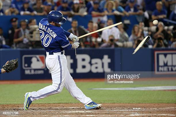 Josh Donaldson of the Toronto Blue Jays breaks his bat in the eighth inning against the Texas Rangers during game two of the American League Division...